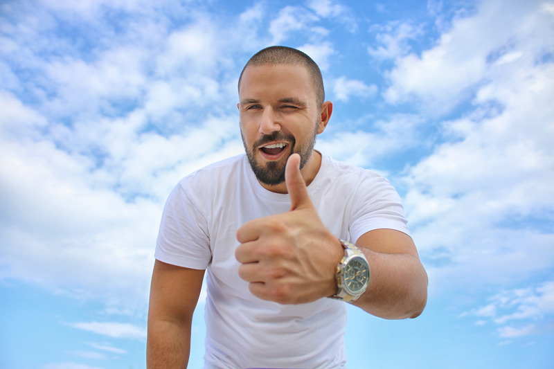 Canva  Man with Thumbs Up Outdoors.jpg
